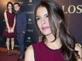 Claudia Traisac wows in pretty knit dress at Escobar premiere as she and rumoured boyfriend Josh Hutcherson keep fans guessing about their relationship